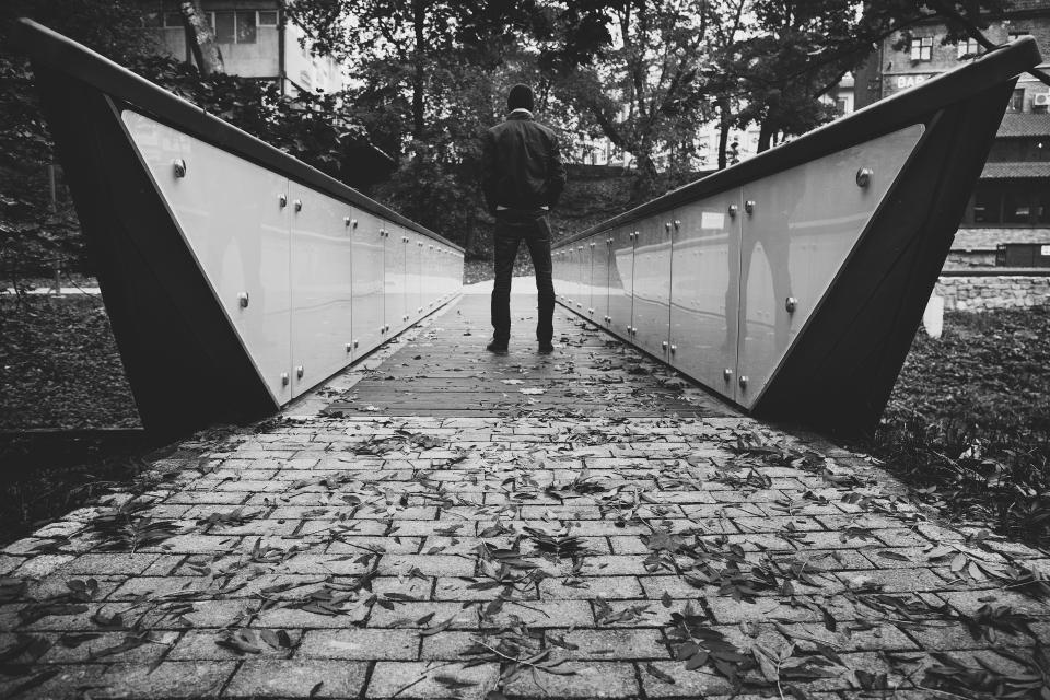 guy man people bridge architecture stones leaves fall autumn outdoors nature black and white
