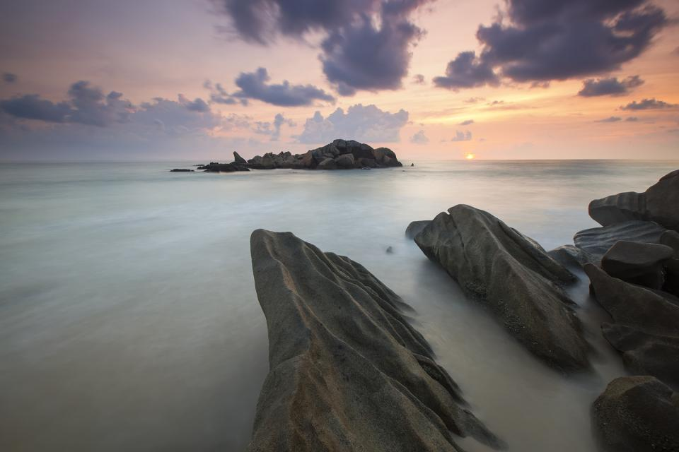 sea ocean rock formation landscape nature waves adventure travel sky clouds