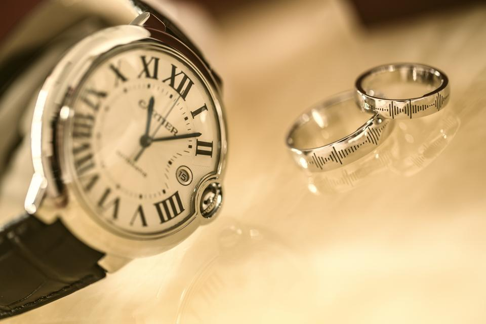 still items things wrist watch cartier couple rings silver glass reflection bokeh