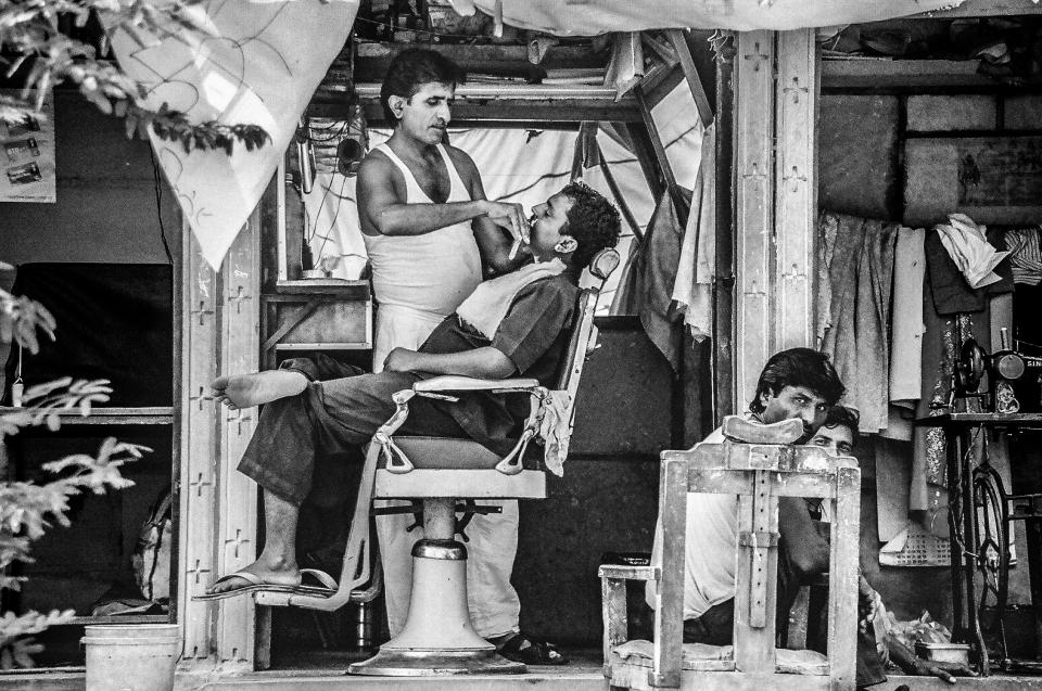 black and white people barbershop barbers men monochrome
