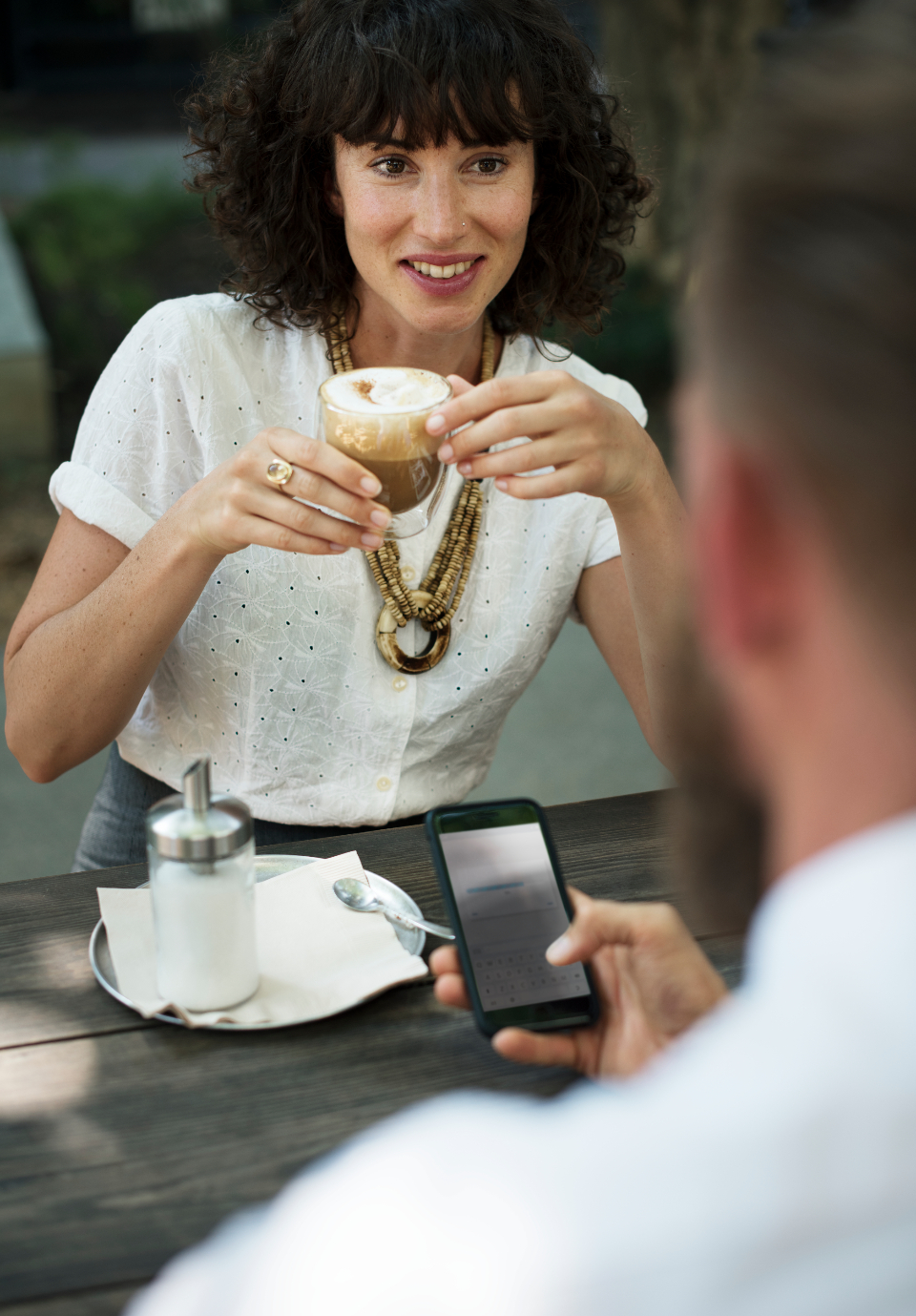cup drinks coffee shop business online friends deal mobile phone friendship networking connection communication coffee agreement brainstorming togetherness table talking corporate beverage planning meeting cafe internet team woma