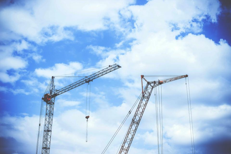 blue sky clouds crane construction