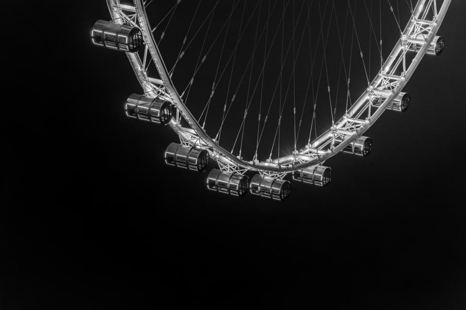 ferris wheel amusement park architecture infrastructure structure night dark lights black and white monochrome