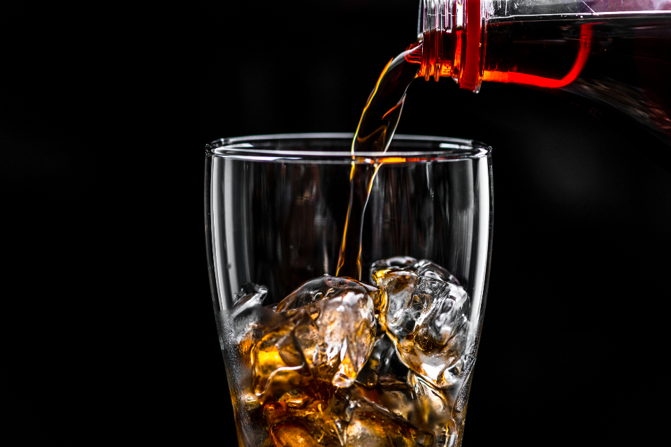 beverage black background bottle bubble caffeine carbonated carbonated drink carbonated water close up cola cold cold drink dehydration drink drinking fizz fizzy flavored flavoring fresh freshness glass ice ice cube liquid macro pop pouring re