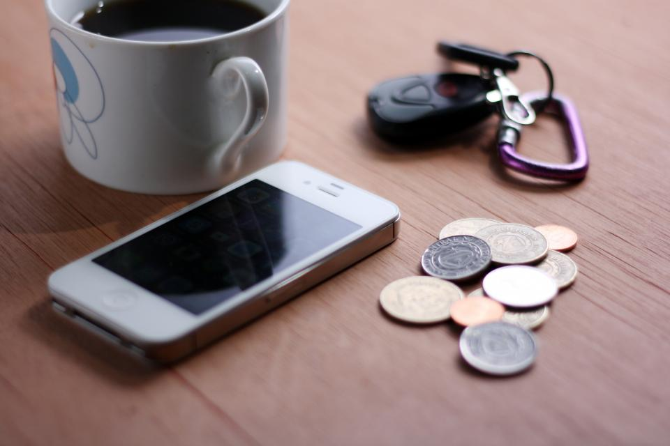 technology gadgets iphone smartphone mobile coins keys mug coffee table still bokeh