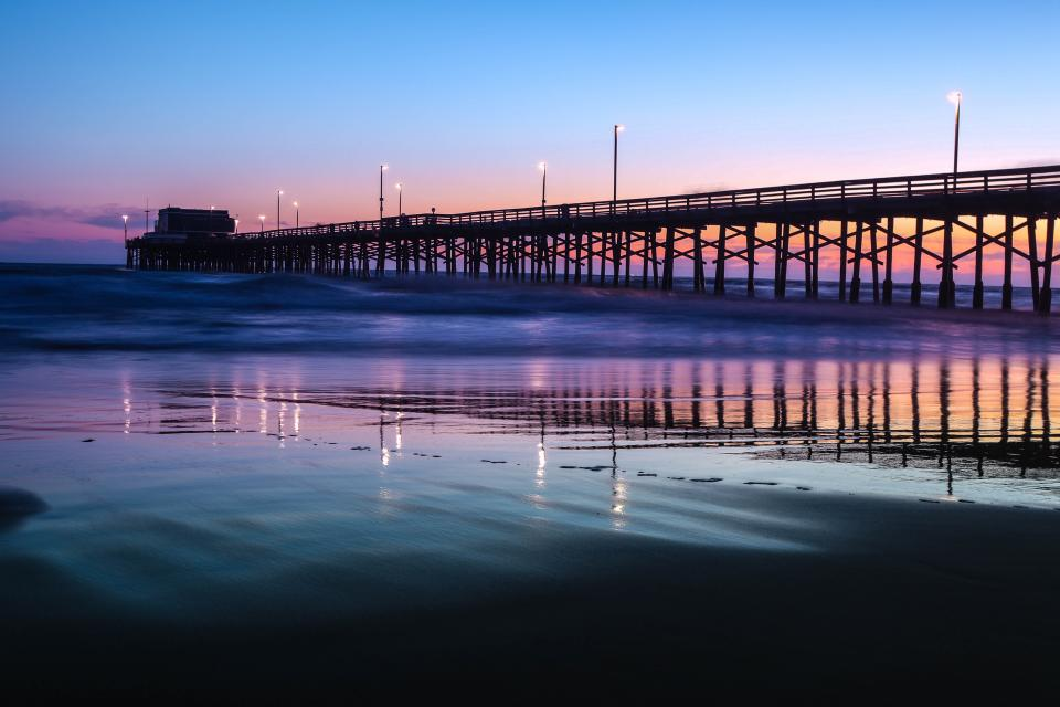 sea ocean water wave nature pier blue sky lights reflection