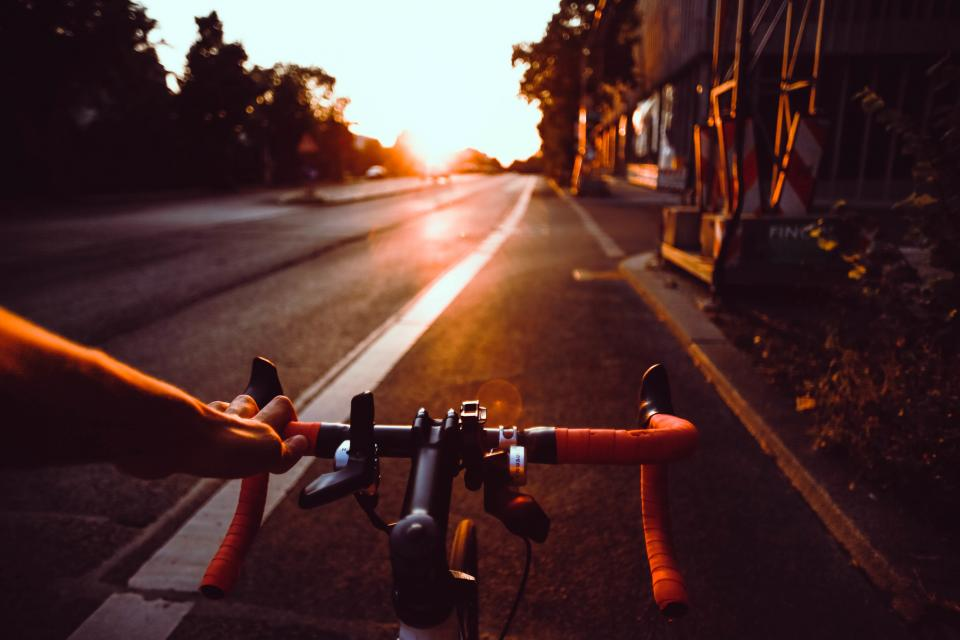 road street bike bicycle cyclist adventure outdoor lane sunrise sunshine sunlight sunset trees sky