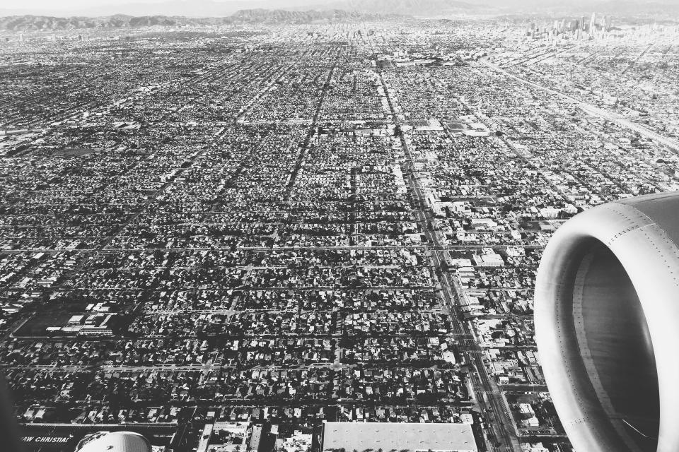 LA Los Angeles aerial view airplane landing travel transportation city black and white