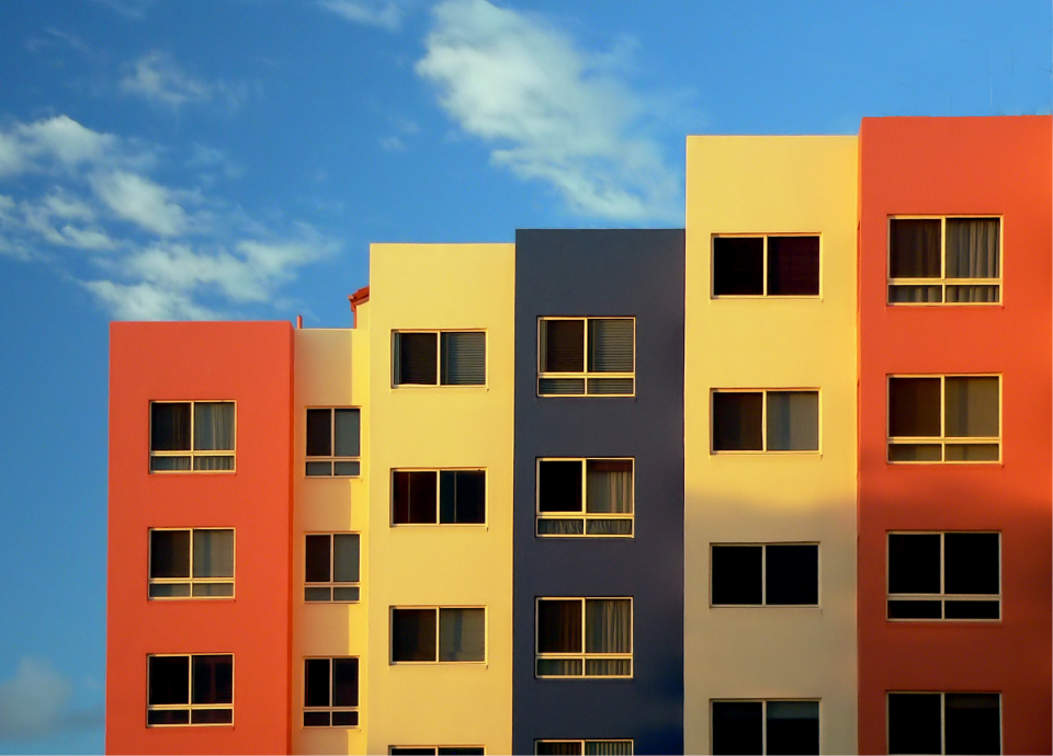 colorful buildings background blue sky windows cityscape apartments vibrant building clouds modern condominium design day block