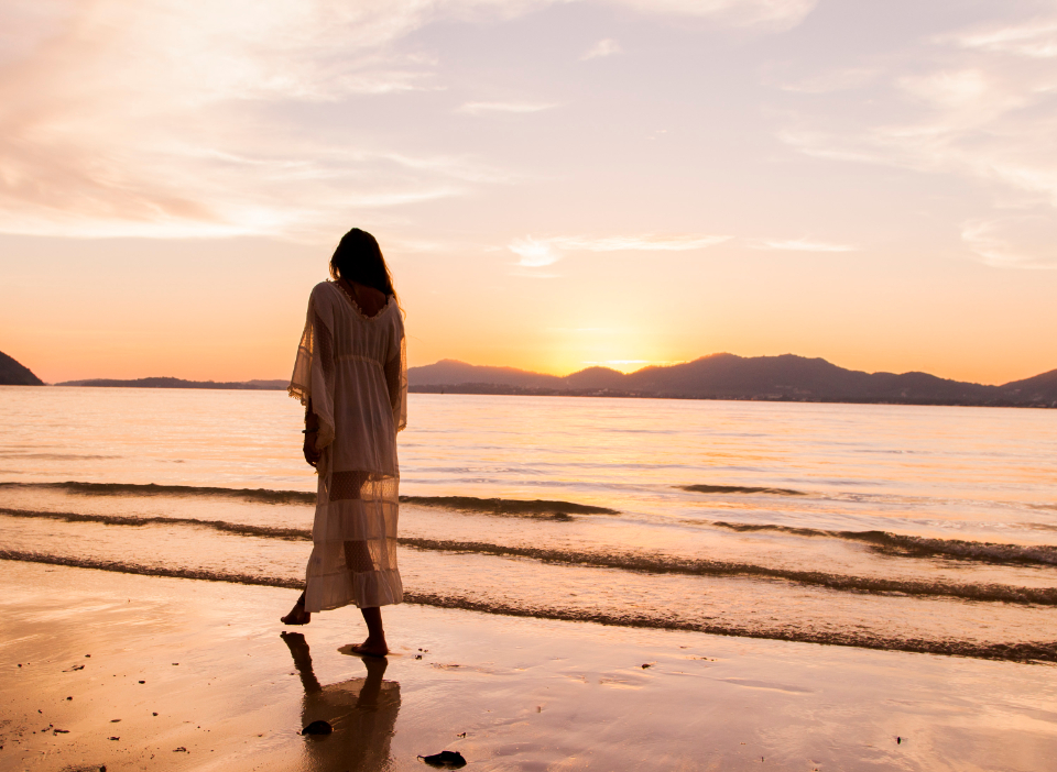 woman beach walk dress long sunset sounrise sun sky sea waves ocean sand people travel landscape