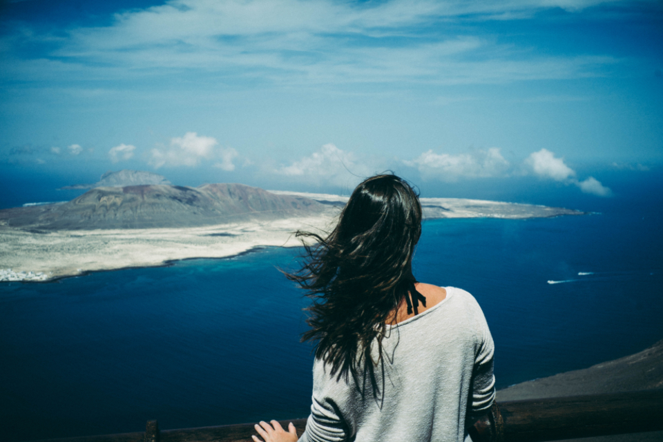woman mountain landscape blue sky sea water ocean hill travel wind female girl