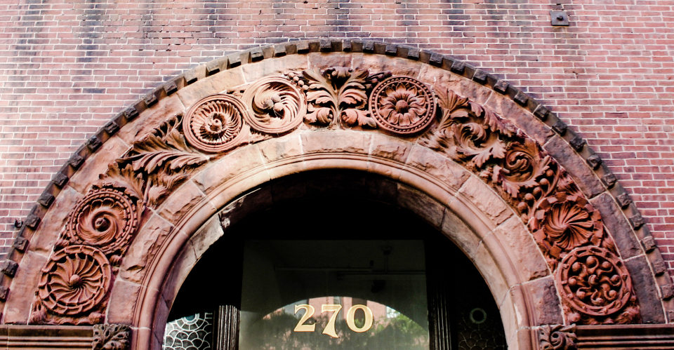 brick entrance arch doorway exterior building city urban architecture wall glass door old weathered numbered