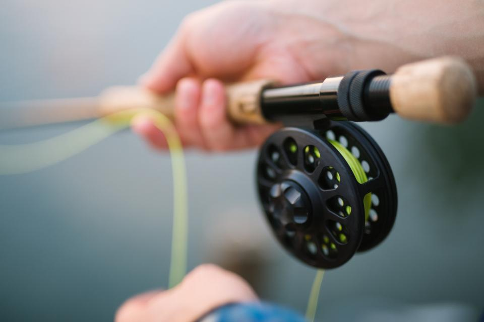 fly fishing blur outdoor hand