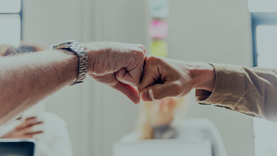 achievement agreement arms business closeup colleagues communication cooperation deal expression fist fist bump friends friendship gesture giving greeting group hands help man meeting men partners partnership people startup