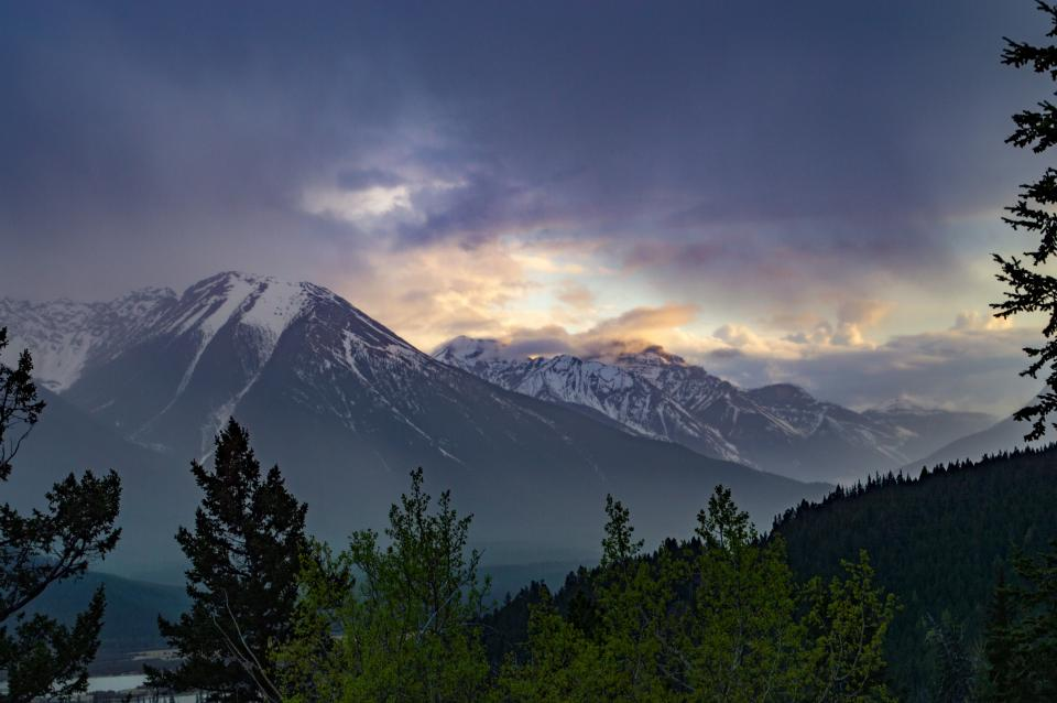 nature landscape mountains summit peaks forests trees snow sky horizon clouds