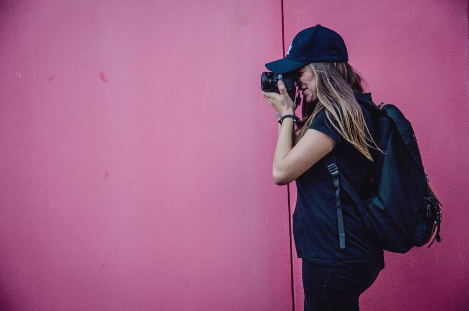 pink walls people girl lady woman photographer camera