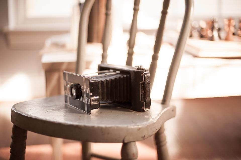 camera old vintage film chair analog