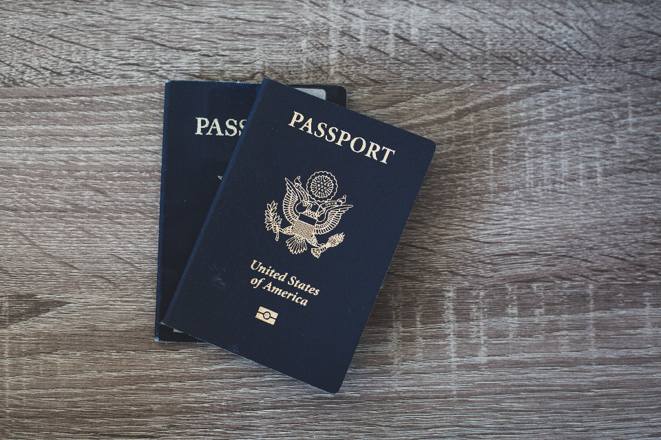 passport table travel close up flat lay wood american document citizen concept identification book