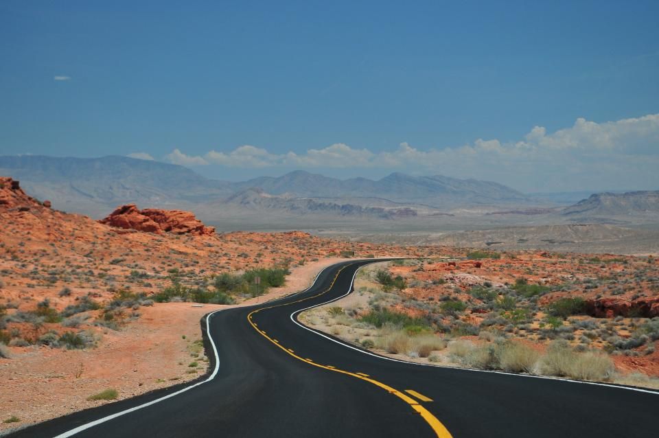 rural road desert landscape nature outdoors blue sky mountains pavement