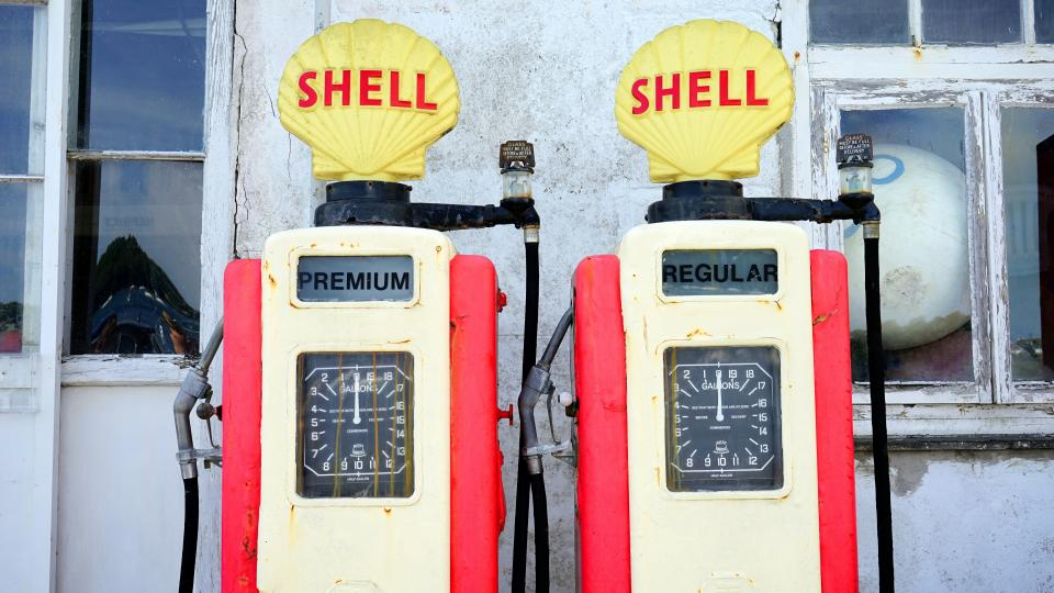 still items things gas station pump machine meters premium regular shell petrol refill windows white wall