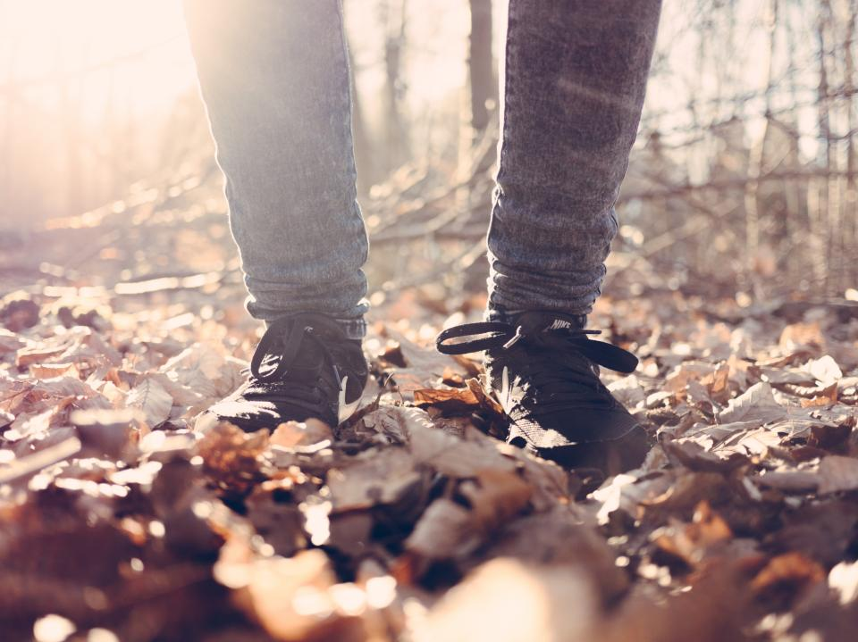 leaf fall blur people travel outdoor bokeh sunrise sunlight leg jeans shoe footwear