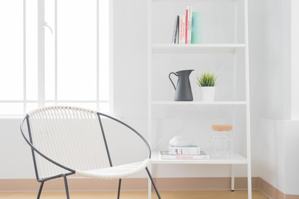 architecture building infrastructure structure shelf garden plant white chair books apartment windows condominium hotel