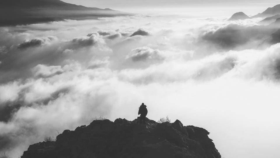 nature landscape mountain clouds sky peak summit travel adventure trek aerial black and white monochrome