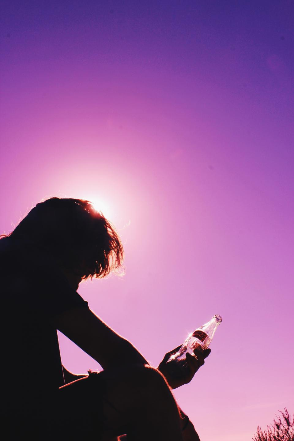 purple pink sky sunset silhouette shadow dusk guy man people glass bottle drink drinks coca cola