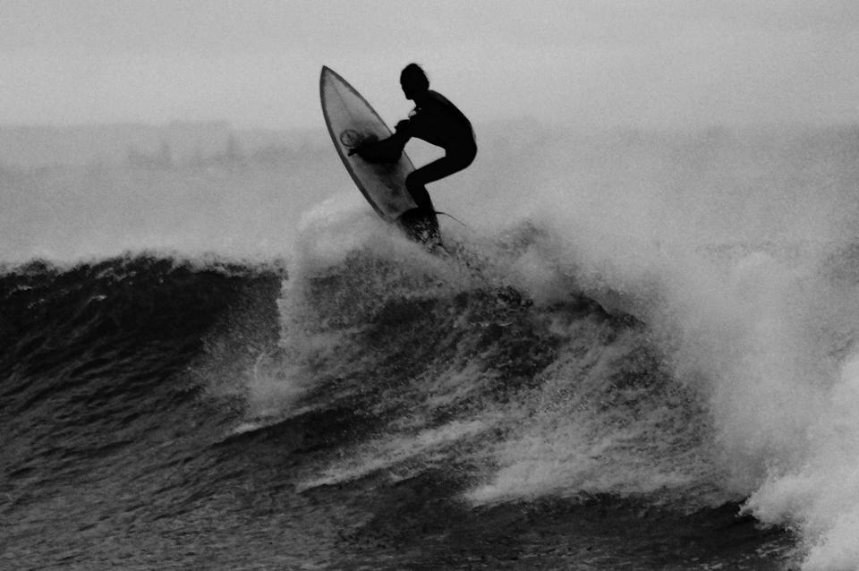 nature water waves crash surf surfer people man guy black and white grayscale
