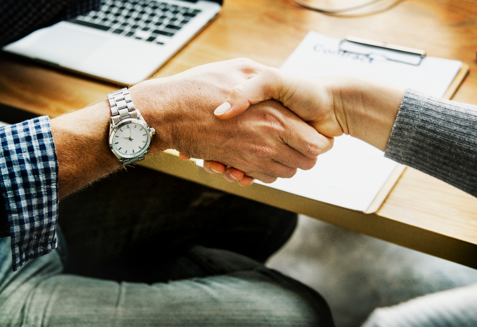 achievement agreement arms business agreement business deal caucasian closeup collaboration colleague connection cooperation deal farewell friends gesture grasp greeting group hands handshake helping hands investment laptop meeting network notebook