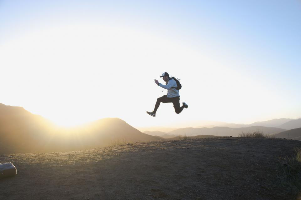 people man jump happy enjoy freedom sunset clouds sky peak summit travel adventure mountain