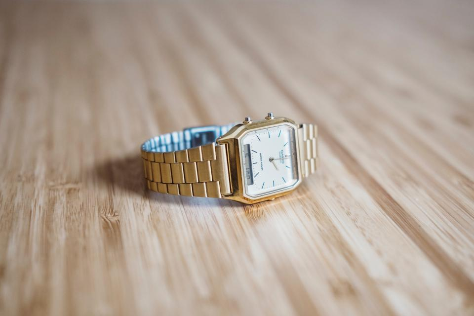 gold watch fashion accessory wooden table