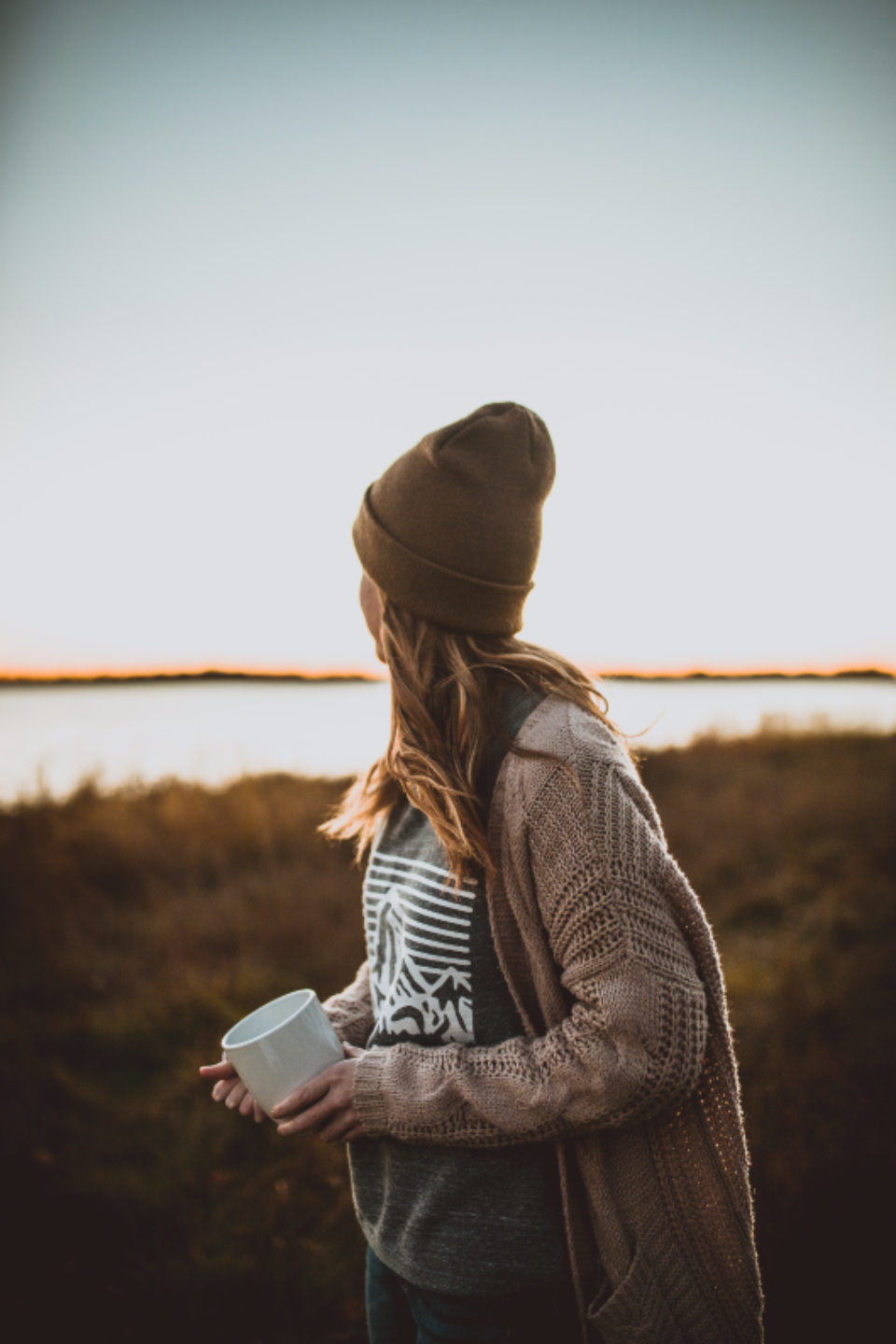 fall sunset girl beanie water lake camping nature earth hipster outdoors mug cold sweater cardigan