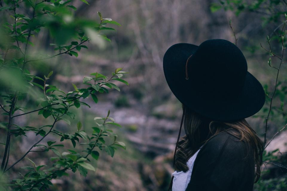 people girl alone tree nature green plant black hat clothing fashion blur