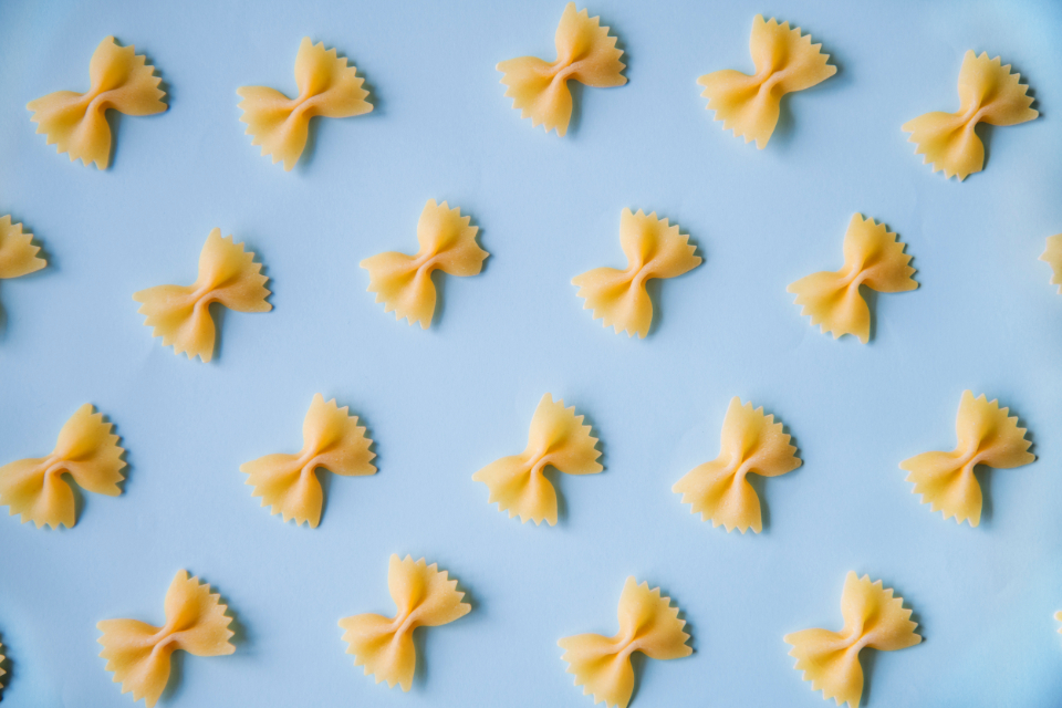background bow carbohydrates close-up closeup colorful cooking eating farfalle flour food gourmet ingredient italian macaroni making meal order organized pasta pastel pattern portion raw twist wallpaper wheat yellow