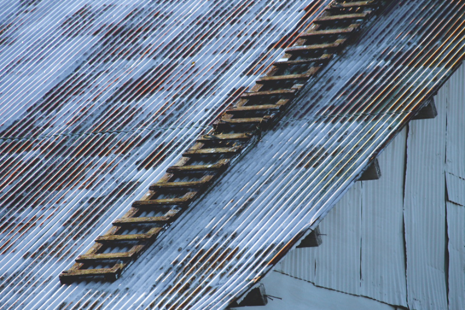 metal roofing exterior building old weathered worn ladder rusty abstract pattern steel barn architecture industrial