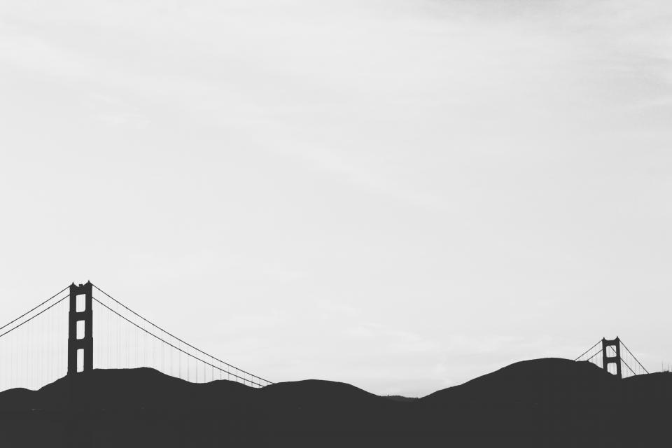 Golden Gate Bridge architecture San Francisco mountains sky black and white