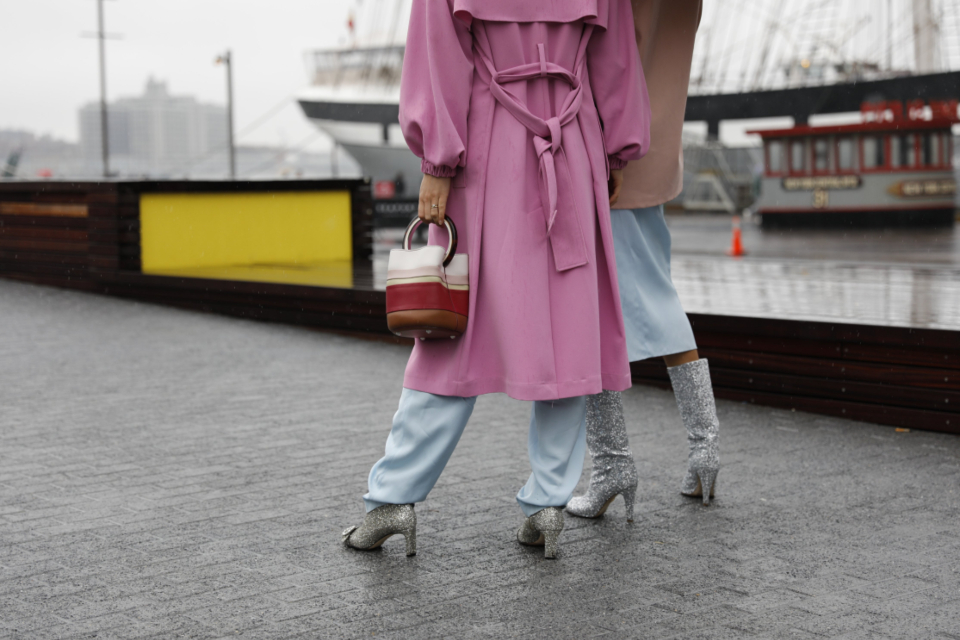 urban heels fashion women females handbag pink coat water view pavement street person city chic