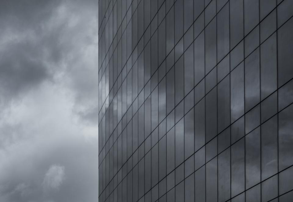 building windows architecture city sky dark storm clouds cloudy tower high rise