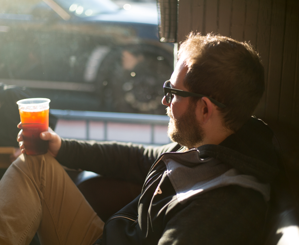 man drinking coffee urban restaurant cafe beverage sitting relaxed daytime tea cup drink breakfast male beard morning person