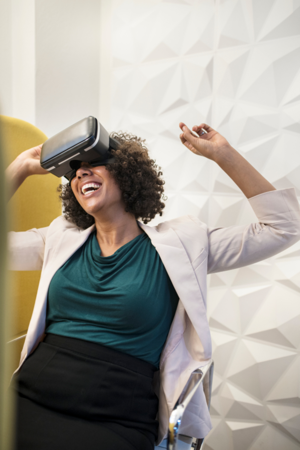 VR virtual reality woman amused amusement entertainment lady female african american afro black businesswoman dancing device digital enjoyment happiness play experience fun game gaming gamer headset indoors innovation technology laughing