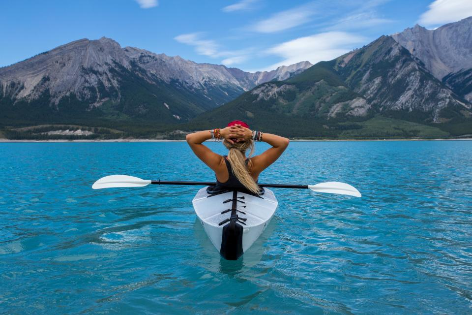 sea ocean blue water boat paddle people girl woman female relax adventure travel mountain landscape sky cloud nature