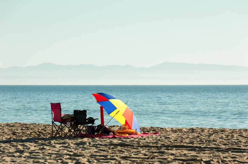 lakeside beach umbrella colorful seat chair vacation relax time slow chill ocean sea water horizon
