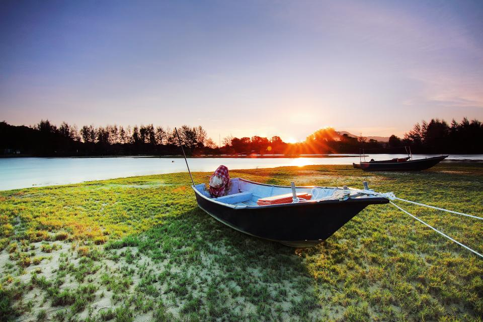 sea water sunlight sunshine sunny sunrise boat people man travel outdoor ground green grass trees plant sky cloud