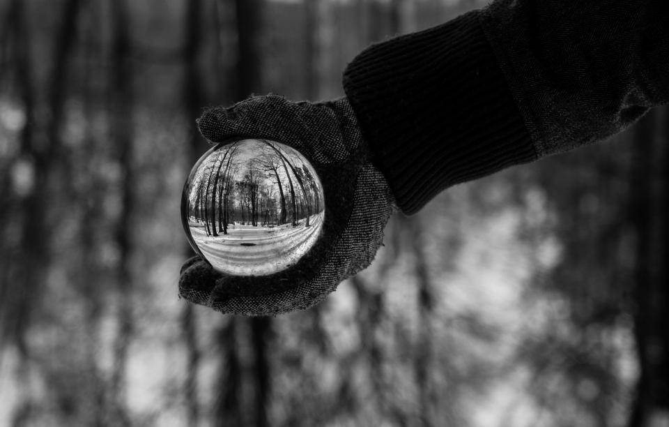 snow winter white cold weather ice trees plants nature woods forest people man gloves snow globe glass circle round