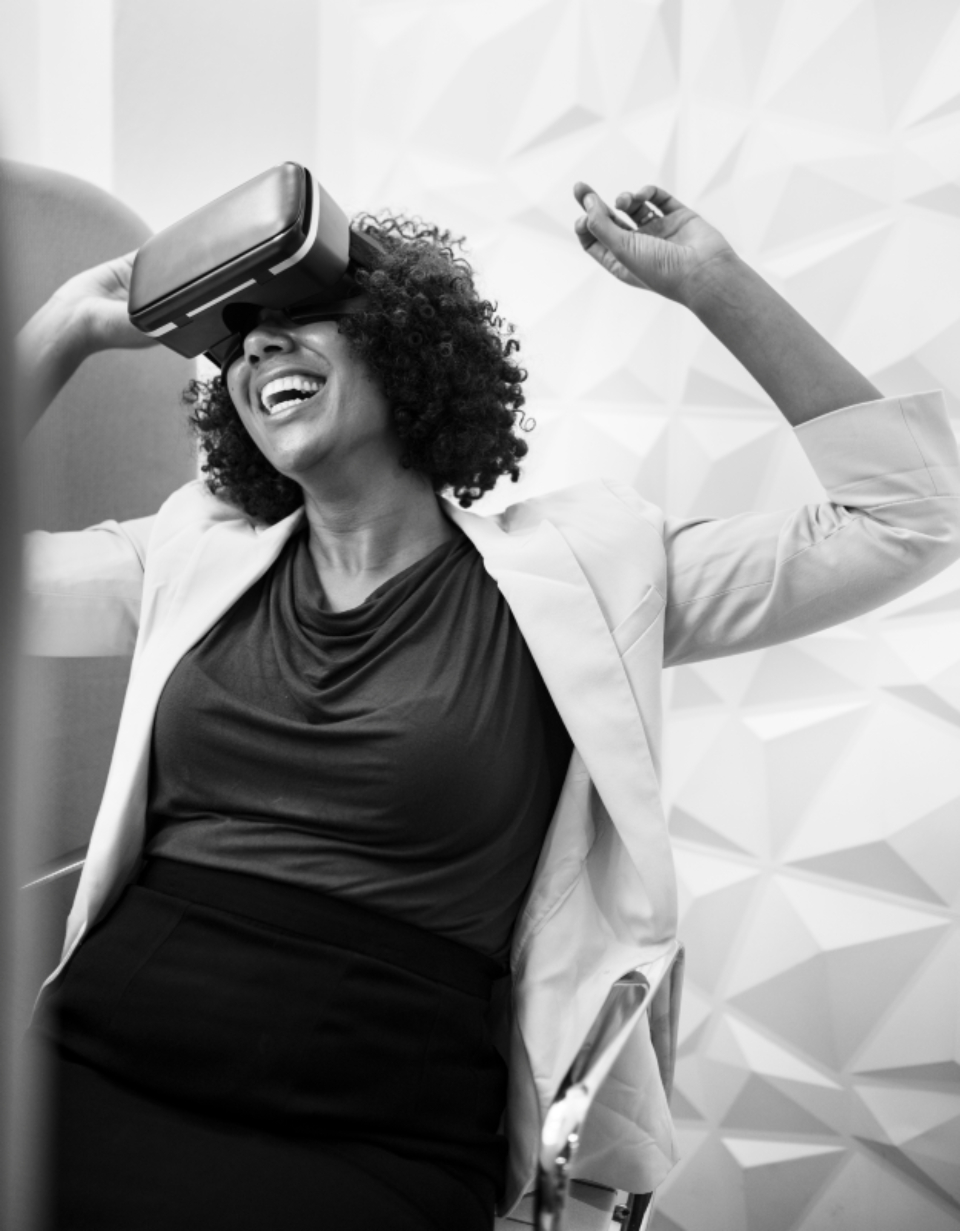 VR amused amusement black and white businesswoman dancing device digital enjoying enjoyment entertainment experience fun funny game gamer gaming grayscale happiness happy headset indoors innovation joyful
