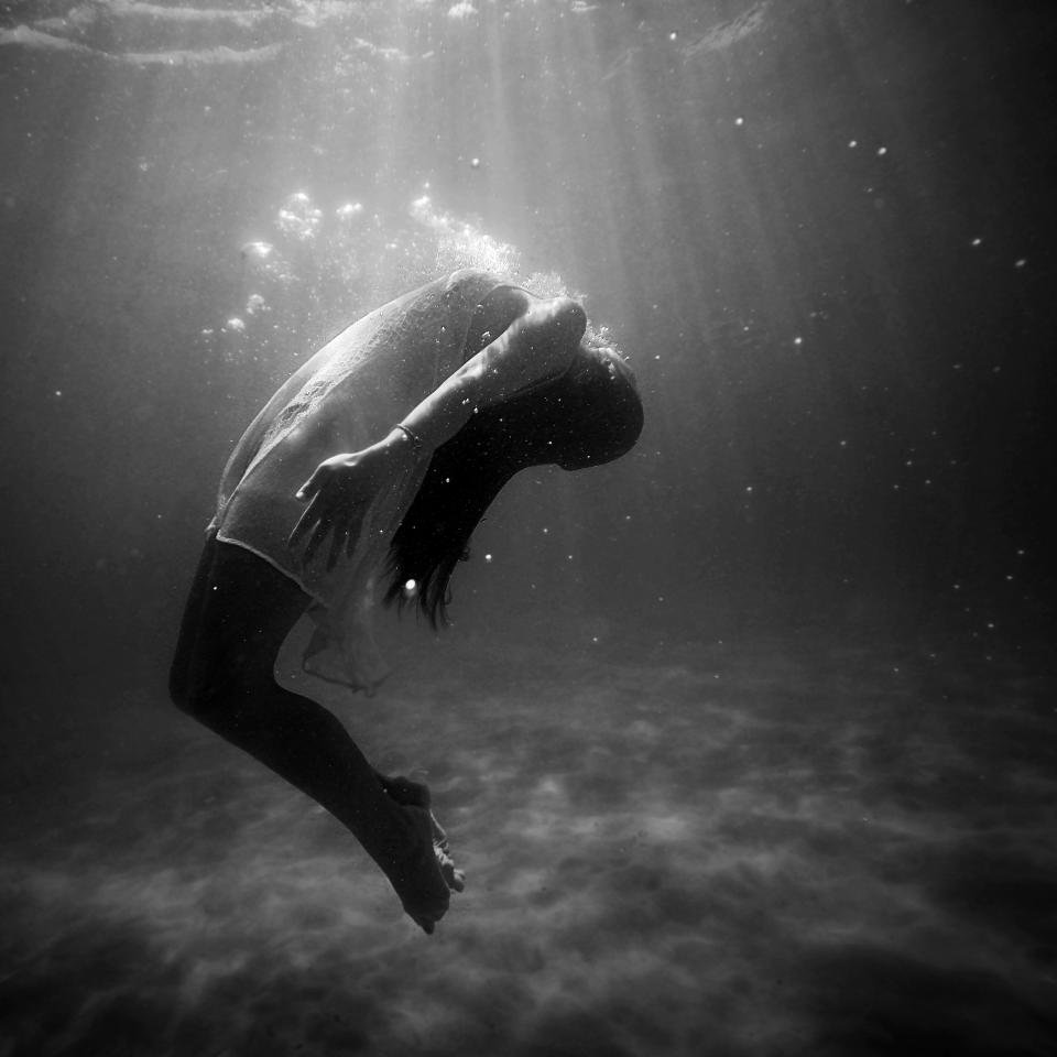 girl woman underwater dress drowning black and white people