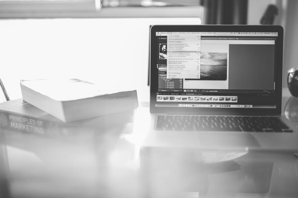 macbook laptop computer creative Lightroom photo books marketing business technology objects office desk black and white window working