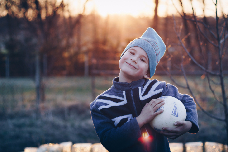 happy kid child proud sunset sun light boy happiness ball portrait park outdoor childhood