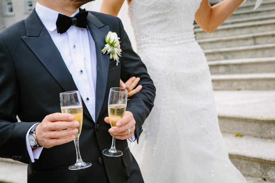 wedding party celebration gown suit wine glass drink bride groom marriage people man woman